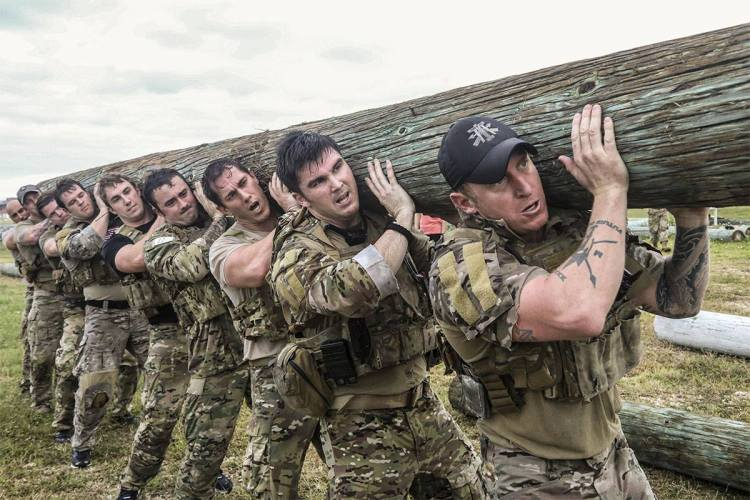 Green Berets training log carrying